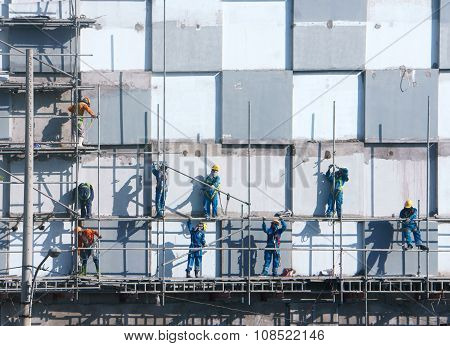 Asian Construction Worker Scraffold, Building Site