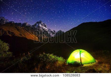 Fantastic starry sky over the mountain Ushba. Dramatic and unusual scene. Location Mestia, Upper Svaneti, Georgia, Europe. High Caucasus ridge. Astrophotography. Beauty world.