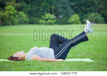 Fat Woman Lying By Exercise Leg Upwards