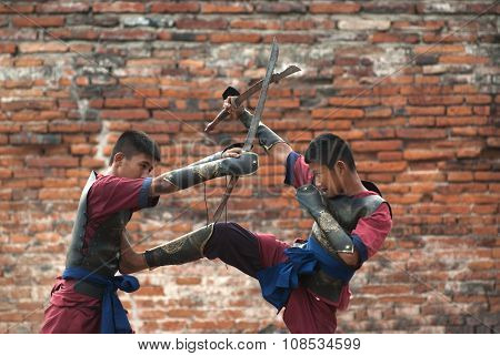 Fighters Take Part In An Outdoor Ancient Thai Fencing.