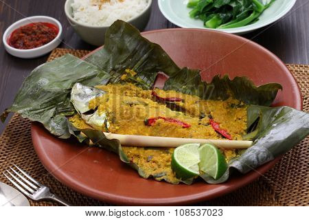 poster of ikan pepes, indonesian cuisine, steamed fish wrapped in banana leaves