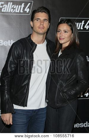 LOS ANGELES - NOV 05:  Robbie Amell, Italia Ricci at the Fallout 4 video game launch  at the downtown on November 05, 2015 in Los Angeles, CA