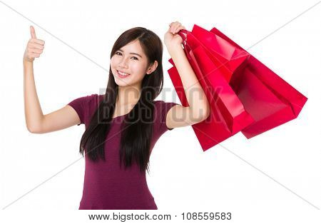 Asian Young Woman carry with shopping bag and thumb up