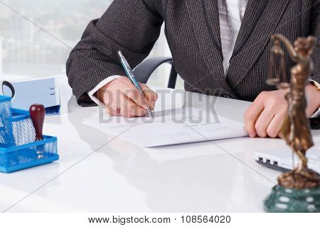 Signing document at office