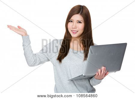 Woman hold with laptop computer and open hand palm