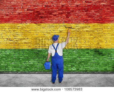 House Painter Paints Reggae Flag On Brick Wall