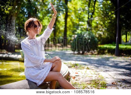 Pretty Woman At The Park Waving To Someone