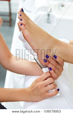 Pedicure dead skin remover foot rasp woman in nail salon poster