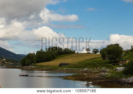 empty coast of norwegian fjord at cloudy day poster