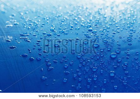 Rain Water Droplets On Blue Fiber