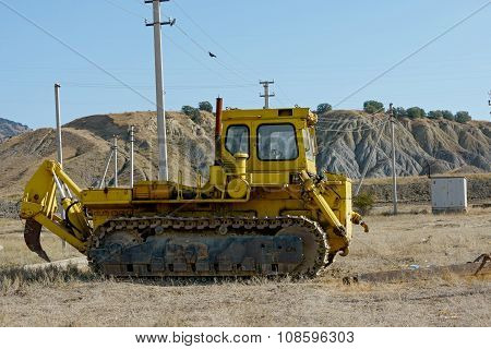 Dozer With Single-tooth Ripper Is At Pipeline Building Place.