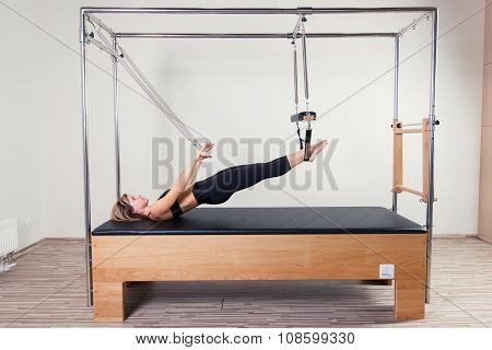 Pilates aerobic instructor woman in cadillac fitness exercise. poster
