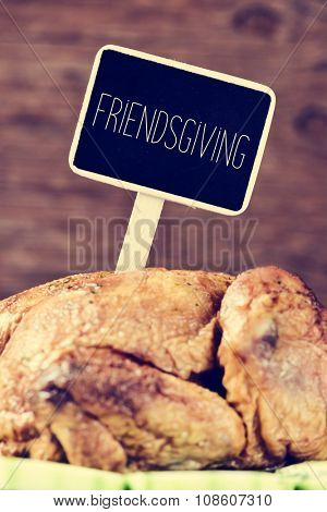closeup of a roast turkey in a tray with vegetables with a black label with the text friendsgiving, gathering thanksgiving with friends poster