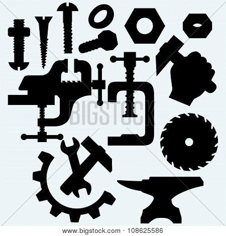 Set of tools: vice, spanner, hammer, circular saw blade, anvil and screws