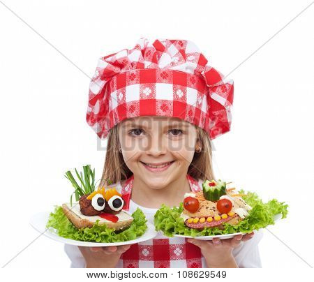 Happy little girl chef with creative sandwiches - isolated