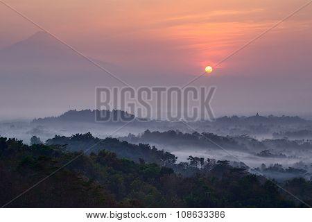 Sunrise At Setumbu Hill With The View Of Borobudur And  Merapi