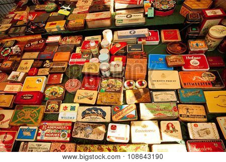Set Of Metal Tins From Cuban Cigars And Cigarettes On Showcase Of Flea-market