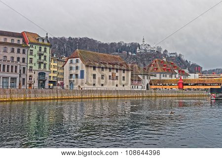 Winter scenery on the embankment of Reuss river in the popular swiss city of Lucerne. It is the fourth largest river in Switzerland poster