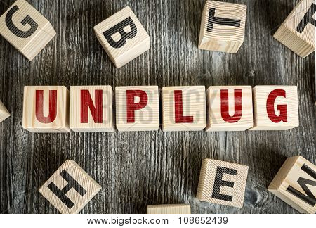 Wooden Blocks with the text: Unplug