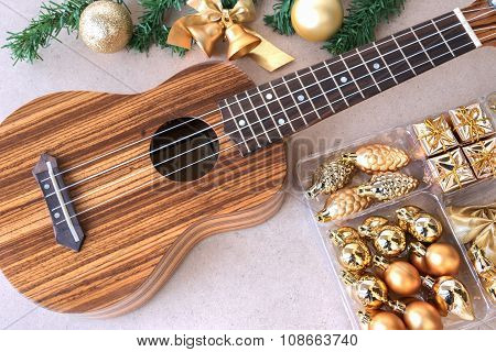 The Ukulele On The Wooden Table With Christmas Decoration Set