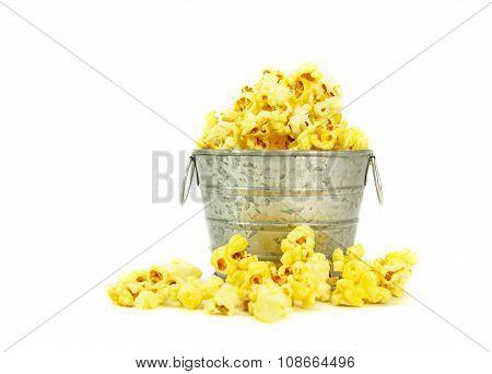 Popcorn in a zinc bucket on white background