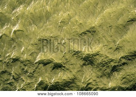 Yellow Water With Sun Reflections Background Texture