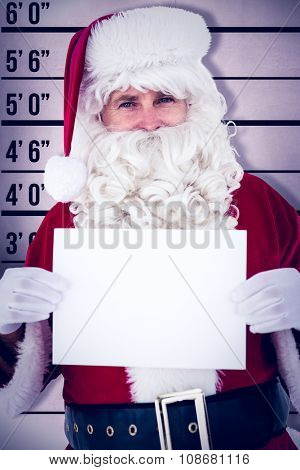 Cheerful santa claus holding page against mug shot background