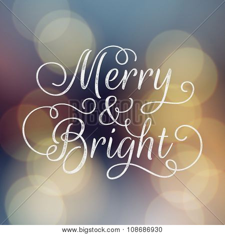 Merry and Bright lettering. Vector ink stamp effect, bokeh background, festive defocused lights.