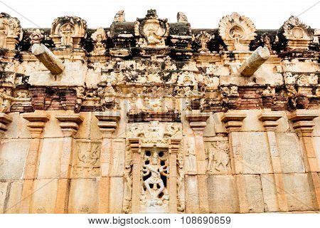 Ancient temple wall depicting Hindu God Nataraja dancing on demon under his legs