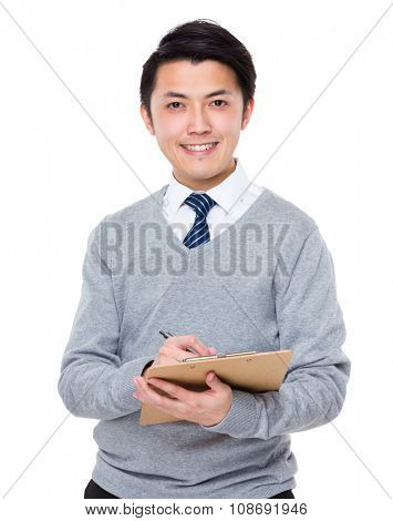 Businessman take note on clipboard poster