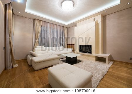 Interior Of A Specious Living Room With Fireplace And Luxury Ceiling Lights