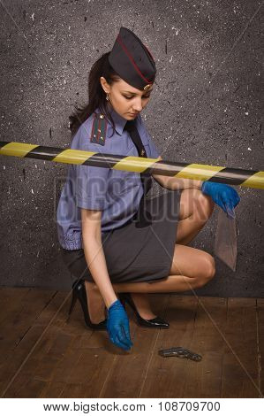 Policewoman Criminalist On A Crime Scene