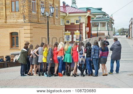 Irkutsk, Russia - May, 18 2015: A Group Of Girls And Photographer On The Street In The City Of Irkut