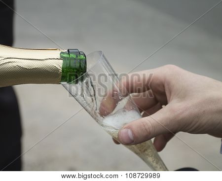 Pouring Champagne To Disposable Cup