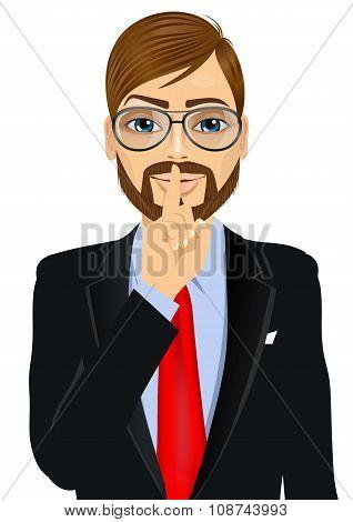 businessman making silence or secret hand gesture