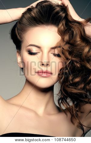 Model with long hair. Waves Curls Hairstyle. Hair Salon. Updo. Fashion model with shiny hair. Woman with healthy hair girl with luxurious haircut. Hair loss Woman with hair volume.