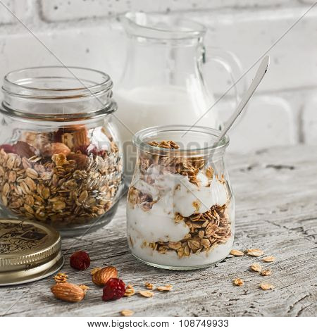 Homemade Granola And Natural Yoghurt On A Light Wooden Surface. Healthy Food, Healthy Breakfast Or S