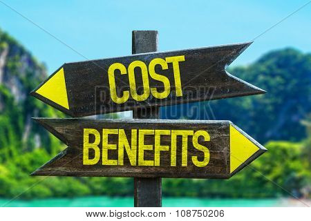 Cost Benefits signpost in a beach background