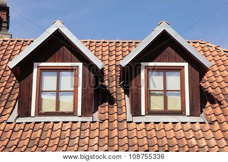 Tiled Roof And Garret Windows In Old House