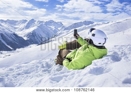 Young men with smartphone mountain winter resort