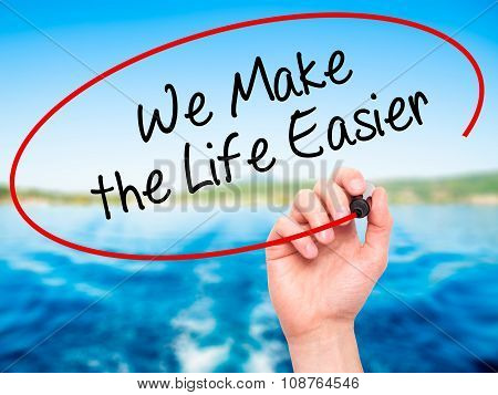 Man Hand writing We Make the Life Easier with black marker on visual screen.