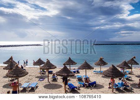 People Sunbathing On The Las Americas Coast,