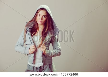 Pensive Teenage Girl In Hooded Sweatshirt. Fashion