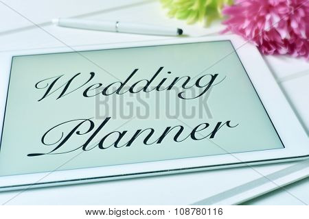 the text wedding planner in the screen of a tablet computer