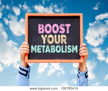 Hands Holding Boost Your Metabolism Written On Chalkboard.