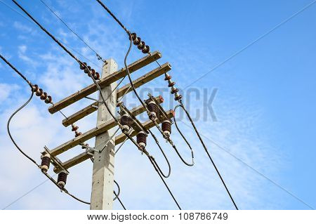Wire Cables On Electricity Pole In The City For Safety Concept  And Blue Sky Background