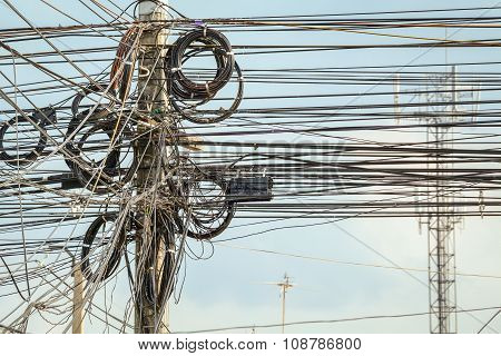 Lot Of Wire Cables Messy On Electricity Pole In The City For Safety Concept,  Background
