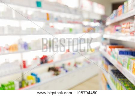 medicine, pharmacy, health care and pharmacology concept - pharmacy or drugstore room blurred background