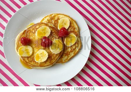 Breakfast crumpets with banana and raspberry