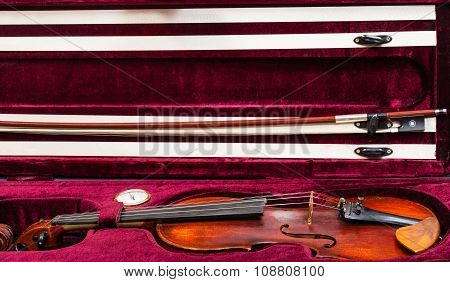 Old Violin With Bow In Red Velvet Case